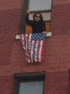 Ed Hale with American flag in New York